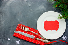 Christmas table place setting with vintage silverware on red nap Royalty Free Stock Image