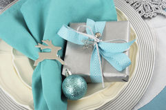 Christmas table place settings in aqua blue, silver and white Stock Photography