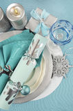 Christmas table place settings in aqua blue, silver and white stock image