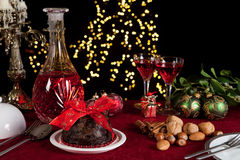 Christmas table with plum pudding Stock Photography
