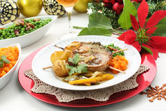 Christmas table with pork medallion dish Royalty Free Stock Photography