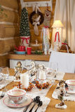 Christmas table set with candles Royalty Free Stock Photos