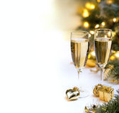 Christmas table set with champagne glasses for postcards Stock Photography
