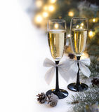 Christmas table set with champagne glasses Royalty Free Stock Photos
