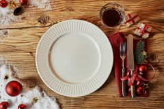 Christmas table set with decorations and a plate royalty free stock images