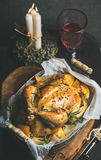 Christmas table set with oven roasted whole chicken and wine Stock Photos