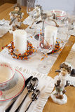Christmas table set with sculptures Royalty Free Stock Photography