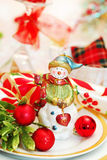 Christmas table set with snowman figurine Royalty Free Stock Image