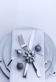 Christmas table set from the top. Plates and silverware for celebration Royalty Free Stock Photos