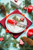 Christmas table setting on blue background with fir tree and decoration Royalty Free Stock Photos