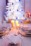 Christmas table setting with blue and white decoration Stock Photography
