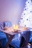 Christmas table setting with blue and white decoration Stock Images