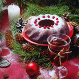 Christmas table setting. Bundt cake sprinkled with sugar powder Stock Photos