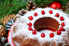 Christmas table setting. Bundt cake sprinkled with sugar powder. Stock Photos
