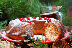 Christmas table setting. Bundt cake sprinkled with sugar powder Stock Photo