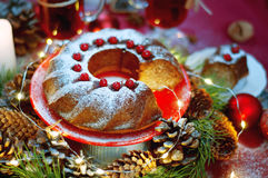 Christmas table setting. Bundt cake sprinkled with sugar powder Stock Images
