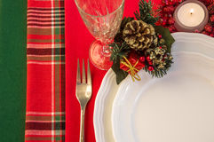 Christmas table setting with burning candle. Royalty Free Stock Photography