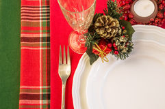 Christmas table setting with candle. Stock Photos