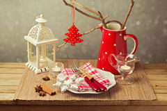 Christmas table setting with christmas decorations and candles Stock Photos