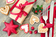 Christmas table setting with christmas decorations and gingerbre royalty free stock photography