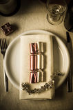 Christmas Table Setting with Crackers Stock Images