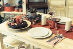 Christmas table setting with decorations stock photos