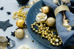 Christmas table setting before dinner. With gold decorations stock images