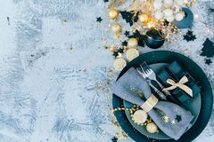 Christmas table setting before dinner with gold decorations. Christmas table setting before dinner flat lay royalty free stock photography