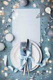 Christmas table setting for holiday dinner top view. Empty paper blank with space for text. Christmas table setting for dinner top view. Empty paper blank with royalty free stock photo