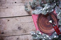 Christmas table setting. Empty  plate, knife and fork, napkin  o Stock Images