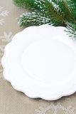 Christmas table setting with an empty plate Royalty Free Stock Photography