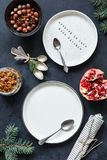 Christmas Table setting with empty white plates, vintage tea spoons, napkin Stock Images
