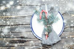 Christmas table setting with festive decorations on bright woode Royalty Free Stock Images