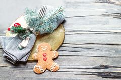 Christmas table setting with festive decorations on bright woode Stock Photos