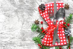 Christmas table setting with festive decorations on kitchen napkin Royalty Free Stock Photography