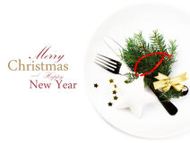 Christmas table setting with festive decorations on white plate Royalty Free Stock Photo
