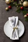 Christmas table setting with fork and knife and christmas decorations on plate royalty free stock photo