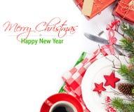Christmas table setting with gift box and fir tree Stock Photo