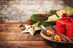 Christmas table setting with gift Royalty Free Stock Photography