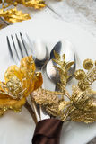Christmas table setting in gold and brown tone on wooden table Royalty Free Stock Photography