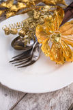 Christmas table setting in gold and brown tone on wooden table Stock Image