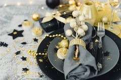 Christmas table setting with gold decorations. Christmas background royalty free stock photo