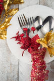 Christmas table setting in gold and red tone on wooden table Stock Photos
