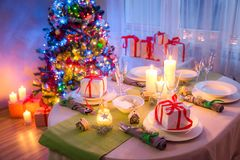 Christmas table setting with green and white decoration Stock Images