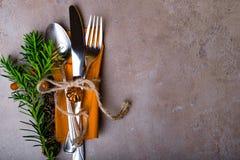 Christmas Table Setting. Holiday Decorations. Decor. New Year Celebration. Christmas and New Year table setting. Holiday decoration, spoon, fork, knife on napkin royalty free stock photos