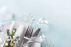Christmas table setting for holiday dinner. Bokeh effect. Copy space for menu royalty free stock photos