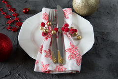 Christmas table setting with plate, kine, fork and decorations Royalty Free Stock Images