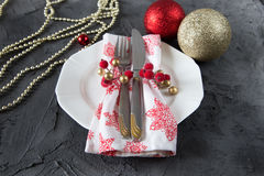 Christmas table setting with plate, kine, fork and decorations Stock Image