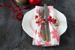 Christmas table setting with plate, kine, fork and decorations.  Royalty Free Stock Image