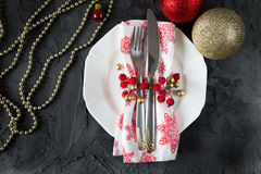 Christmas table setting with plate, kine, fork and decorations.  Stock Photos